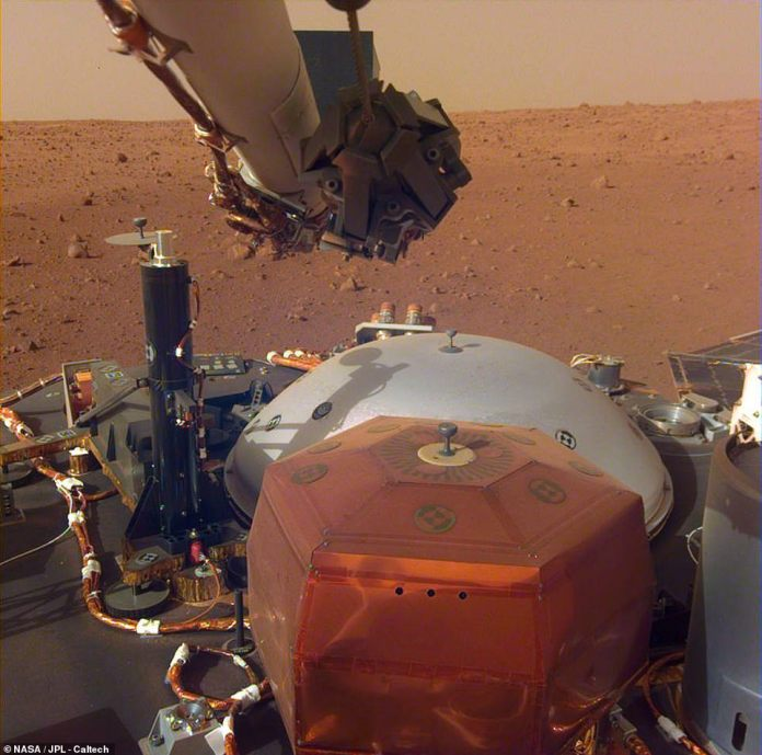 NASA's InSight Lander has finally removed the lens cover from the cameras, allowing the robot researcher to capture his most crisp images of his new home