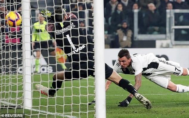 Mandzukic kept an eye on the ball as he beat Slovenian Samir Handanovic in the Inter goal