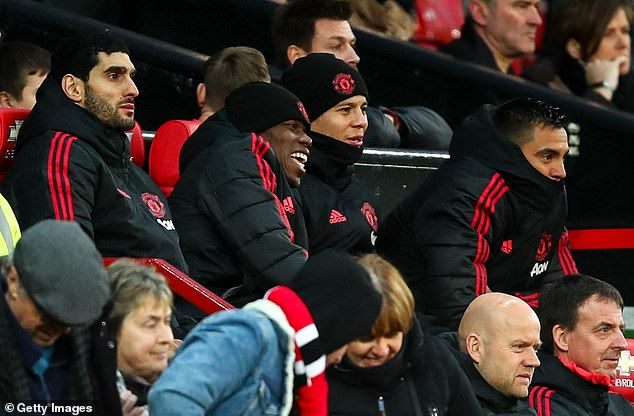 Pogba was seen grinning while watching United from the bench as they hammered Fulham 4-1