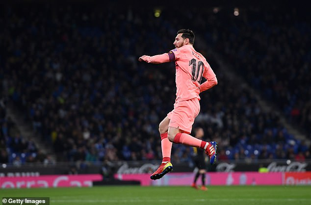 Lionel Messi celebrates after scoring the first goal forf Barcelona on Saturday night