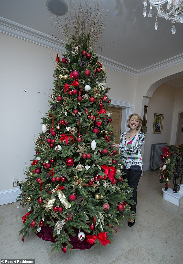 Sonya Latham and her husband Paul spent £ 2,000 decorating the three trees in their household - one of which is an 11-foot tree adorned with red and gold bullets that stands in the lobby