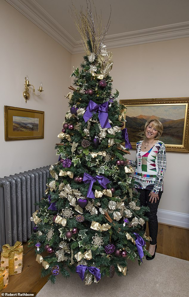 In a second reception room is another 9-foot tree, this time decorated in gold, purple and ivy