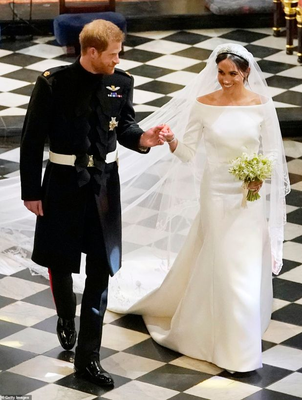 The minimalist wedding gown designed for the Duchess byClare Waight Keller of Givenchy - which won the designer tonight's celebratedBritish Designer of the Year Womenswear Award - had a boat neck framing Ms Markle's shoulders and a five metre long white silk veil which included floral detail representing all 53 countries of the Commonwealth