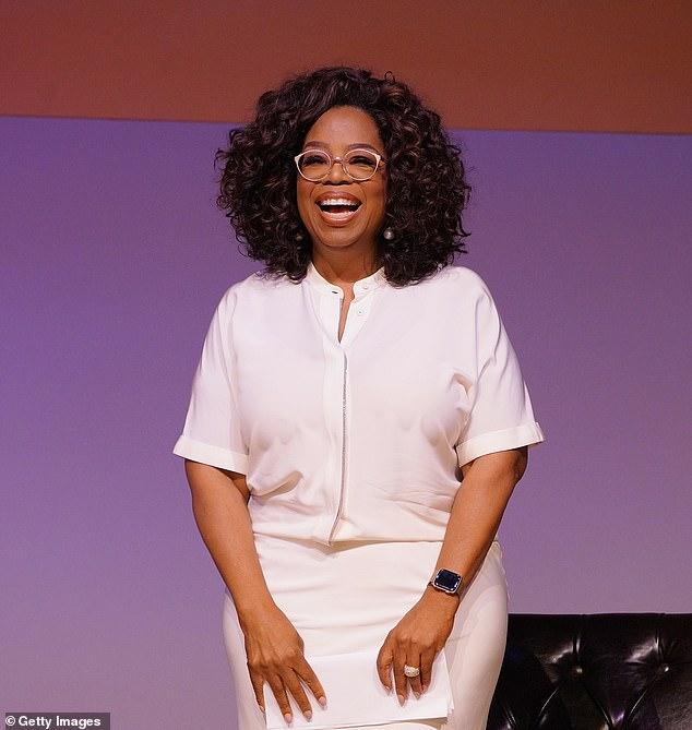 Third spot:Oprah Winfrey, pictured in 2018 in Johannesburg, landed in third with $2.8 billion
