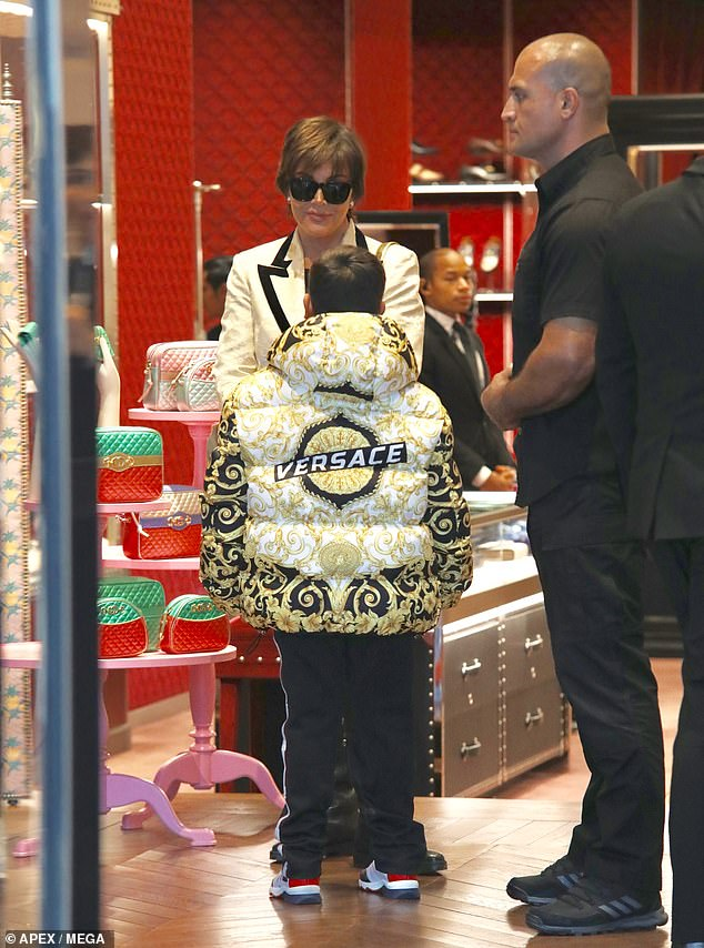 Bodyguard:Mason and Kris were accompanied by a large bodyguard dressed in black, who was seen carrying a large Versace bag