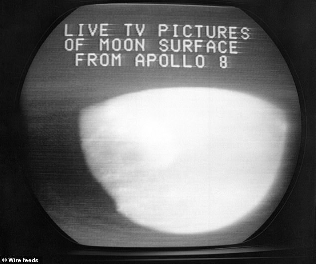 This Dec. 24, 1968, file photo shows a television screen with a view of the moon transmitted by the Apollo 8 astronauts as it orbited. The curves within the television image are caused by the edges of the spacecraft windows and the lunar horizon