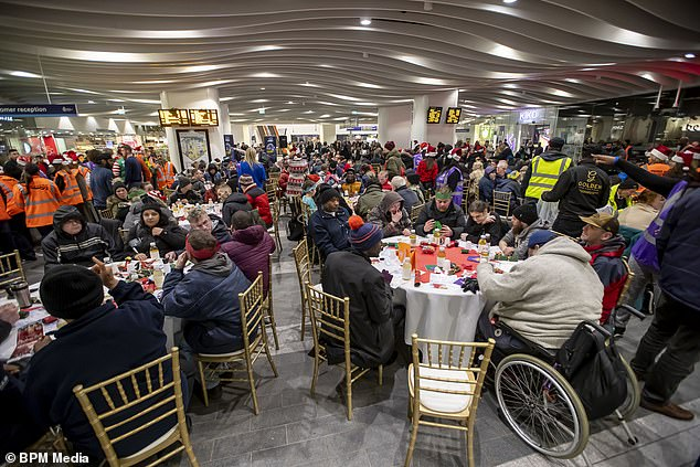 New Street Station in Birmingham was transformed into a dining hall for 200 homeless people to enjoy a Christmas feast
