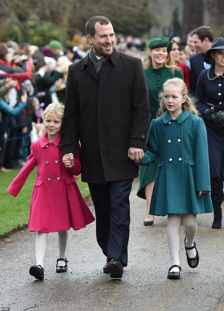 Peter Phillips with his daughters Isla (left) and Savannah  arriving to attend the Christmas Day morning church service at St Mary Magdalene Church in Sandringham