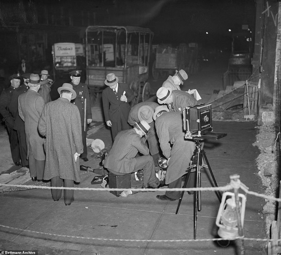 Policemen are pictured in 1937 at the scene of the murder of Johnny La Polla