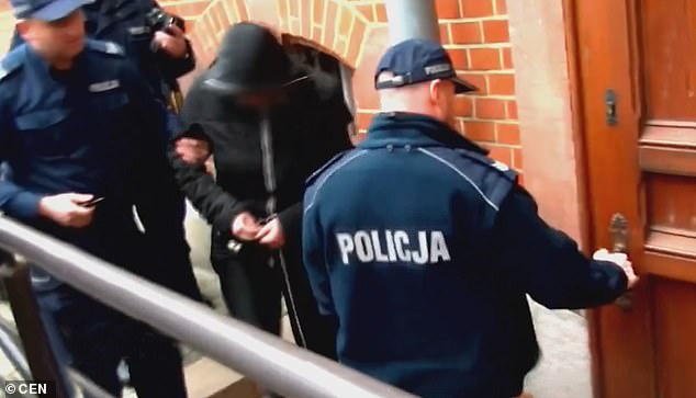 Dawid W being arrested by the police. He is accused of helping his partner, Aleksandra J, to suffocate their four babies with plastic bags
