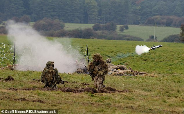 British Army personnel are pictured as they carry out exercises on Salisbury Plain in October 2016 (stock image)