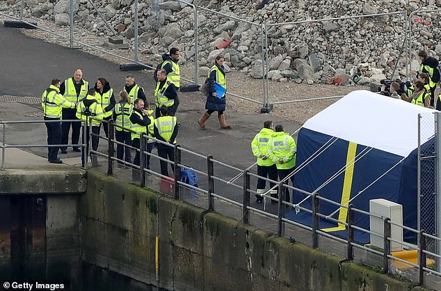 British immigration minister Caroline Nokes shakes hands with Uk Border force staff at Dover Marina