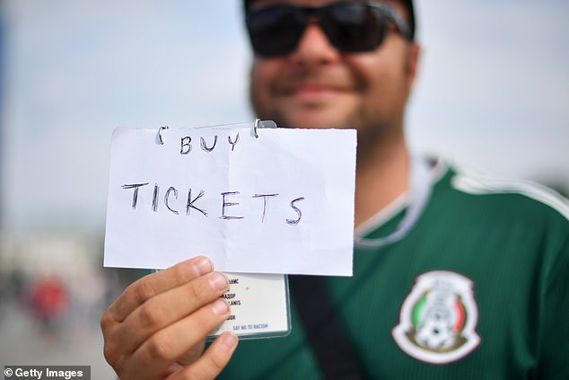 One Mexico fan held a sign showing a need for tickets and touts were kept busy by supporters