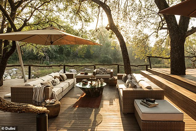 The MP and his wife and children has been vacationing at the luxury Dulini lodge (pictured), which boasts a veranda 'with views of the wilderness beyond', a wine cellar, gym and private plunge pools