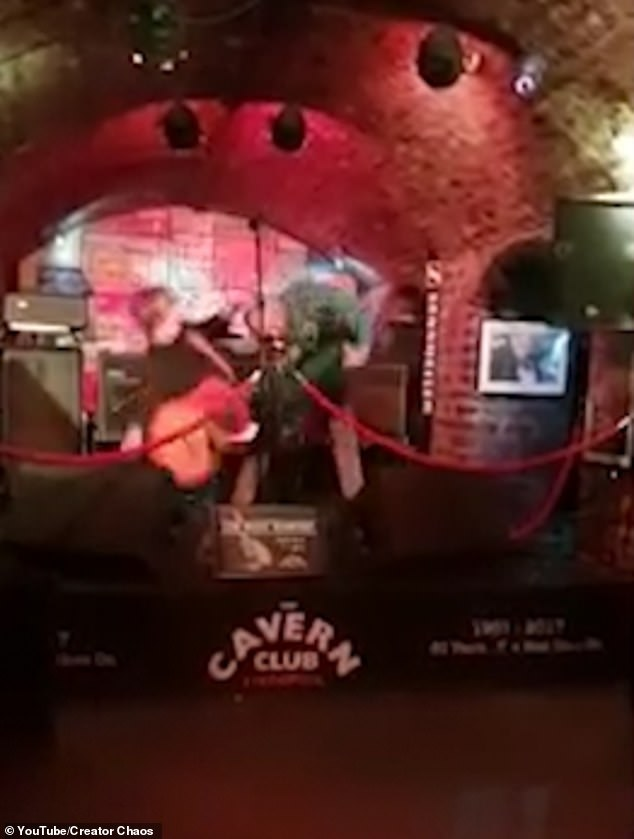 Singer Jay Murray is picked up by his feet and thrown to the ground by a stranger at The Cavern Club in Liverpool