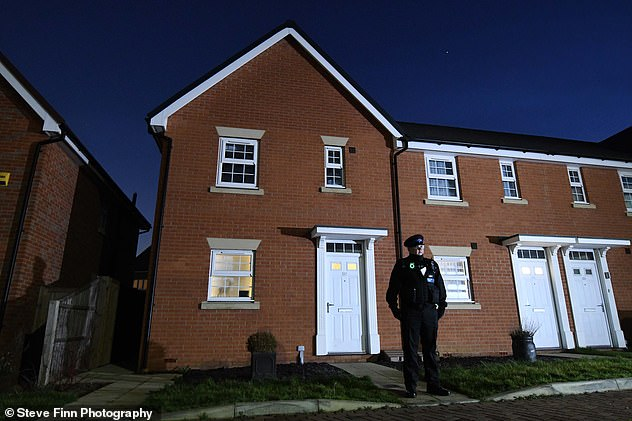 The children were found injured in this home on Castle Drive and were taken to hospital where they were declared dead. An officer stands guard outside the property
