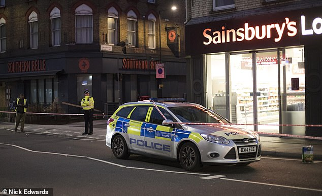 Polive officers cordoned off a road in Hammersmith, west London in the early hours of this morning following a stabbing