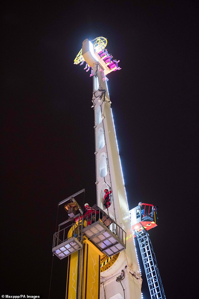 Bad start to 2019: Eight people ended up stuck on top of a 170ft tall fairground ride in Rennes, France, when the carousel broke down at 8.30pm on New Year's Eve