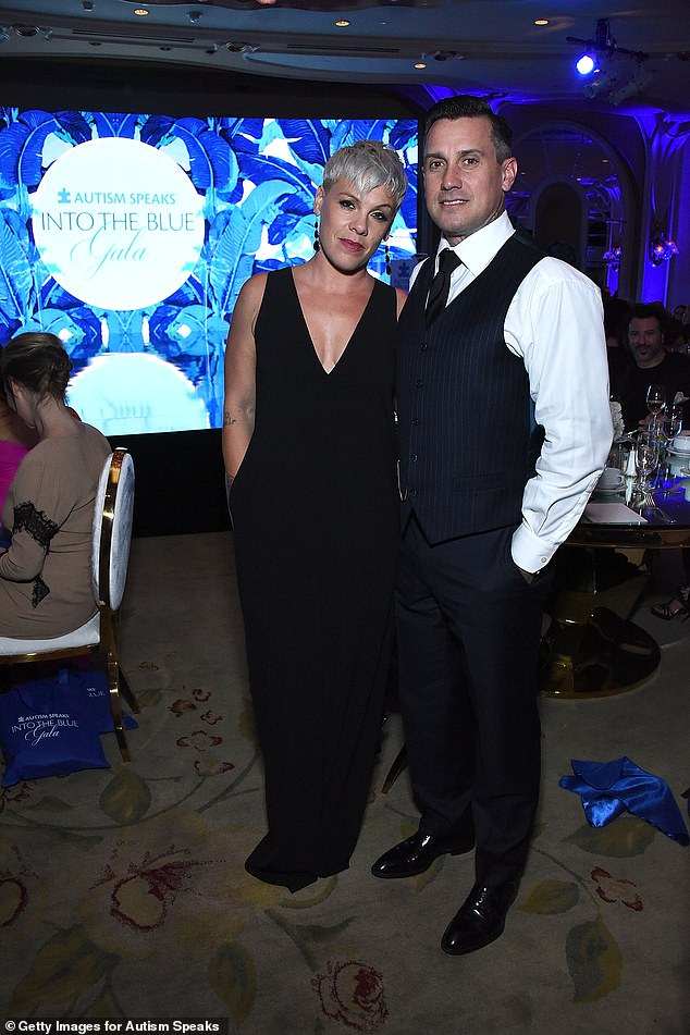 Wine tourism: Pink immersed herself in winemaking courses and visited the great wine-producing regions of the world; pictured with husband Carey in October in Beverly Hills
