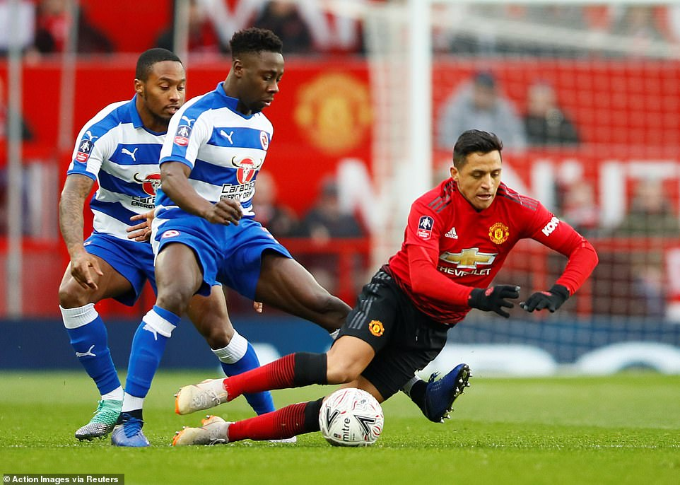 Alexis Sanchez, making his first start for Manchester United in nearly two months, takes a tumble under Andy Yiadom's tackle