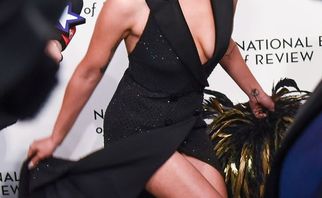 Lady Gaga Stuns In Plunging Black Gown With Thigh High