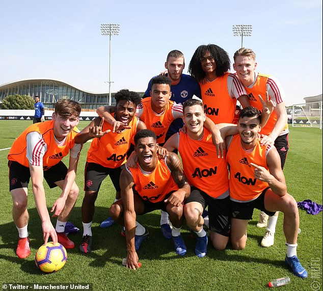 Some of the club's buoyant stars pose on Wednesday after winning a training match in Dubai