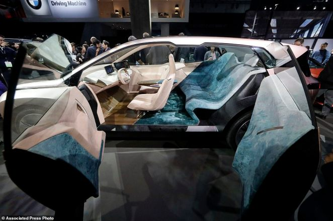 The BMW Vision iNEXT concept car is shown during the Los Angeles Auto Show in Los Angeles. Inside, it features something BMW calls 'Shy Tech.' These control interfaces are integrated into the interior materials and only appear when your hand touches a specific point