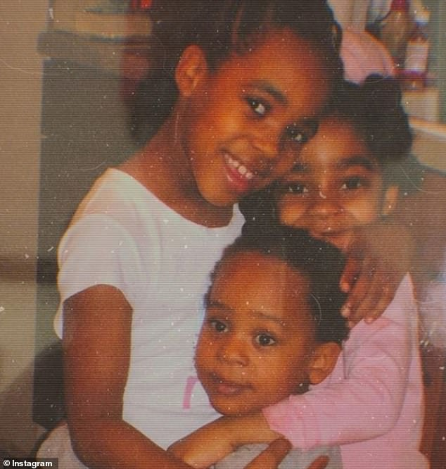 Family: Kelly's three children are shown in an old photograph. Now, they are 21, 19 and 17 and have no relationship with him