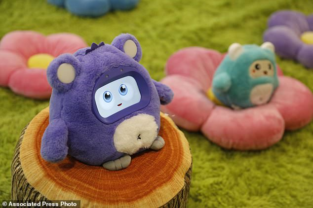 The cute hairy Woobo, thought to be a real-life version of a child's imaginary friend who can help set up routines to brush their teeth, answer complex questions and play educational games. A talking robot Woobo is on display at the Woobo booth