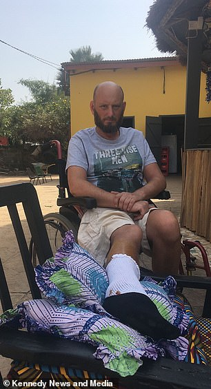 Mr Blurton is pictured in The Gambia on Christmas Day 2017 - the day after he came out of hospital following a ten day stint on antibiotics