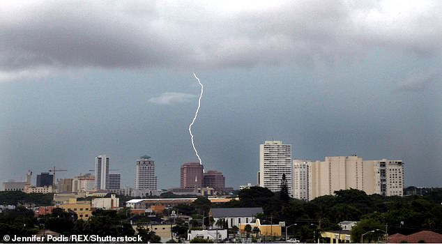 Florida is vulnerable to thunderstorms and lightning because it is on a peninsula and has a tropical climate and the humidity and heat they experience. In the photo, lightning strikes a building in Palm Beach (image)