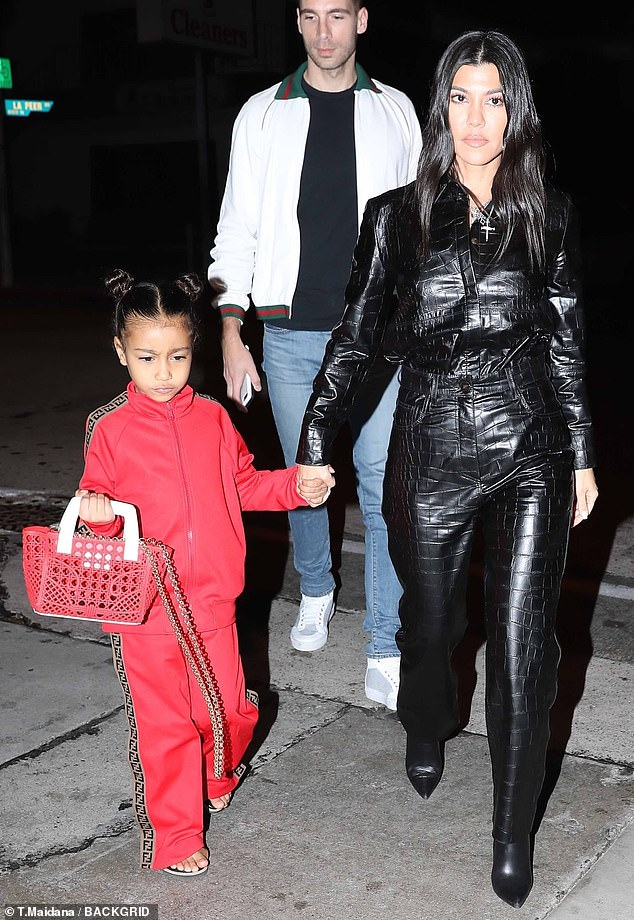 Grandson in fashion: her niece North wore a red Fendi suit, while she was wearing a red handbag
