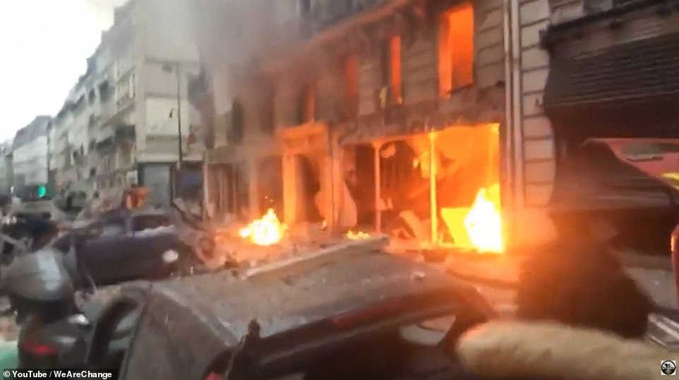 A line of cars was destroyed by the blast which caused fires to break out in the popular bakery in north-eastern Paris