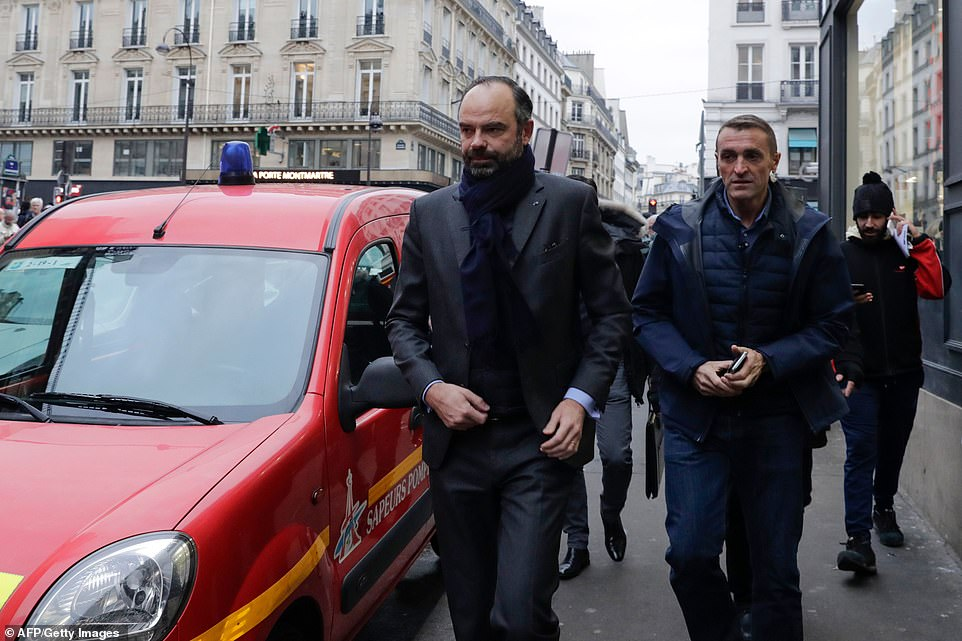 French prime ministerEdouard Philippe, left, arrived at the scene of the explosion this morning to inspect the damage