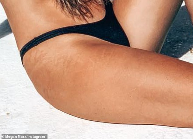 Showing her fans:She captioned the photo: 'Stretch marks are hot'. Visible on her tanned legs were light stretch marks, which circled part of her upper thigh and part of her hip