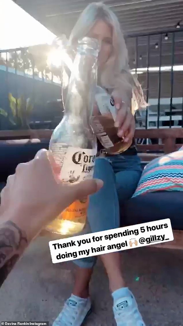 'Thank you for doing my hair angel': Later, the former reality star was seen toasting her female friend with a Corona