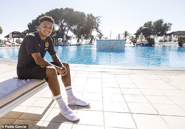 Jadon Sancho takes a glorious winter sun during a training camp in the winter