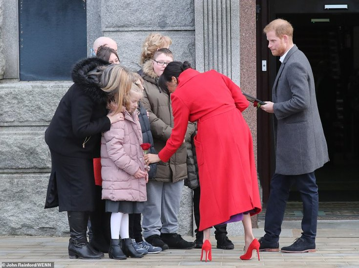 Making friends: The couple stopped to speak to a young fan during their pit stop at Hamilton Square this morning, the first of four engagements in Birkenhead today ahead of the birth of their first child in late April or early May