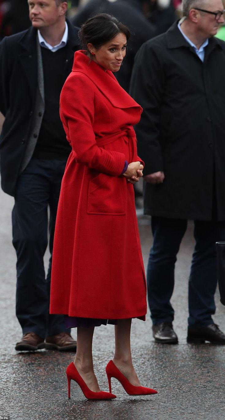 Meghan brought a burst of colour to a dreary winter's day in her red Sentaler coat. Local MP FrankField, who has served Birkenhead since 1979, wrote to the couple himself and said he was 'absolutely thrilled' when they accepted his offer
