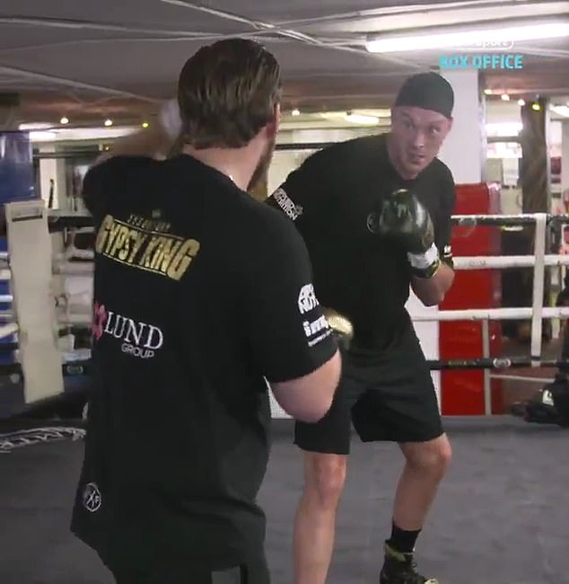 The former unified world champion is currently training out in Marbella with Ben Davison (L)