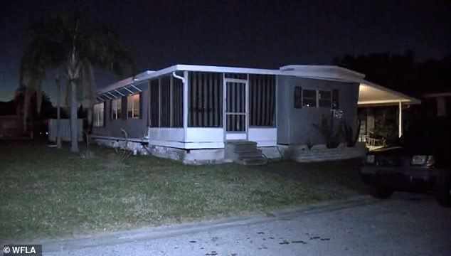 The teen is said to have been found living on a small mattress surrounded by animal cages and feces in this trailer