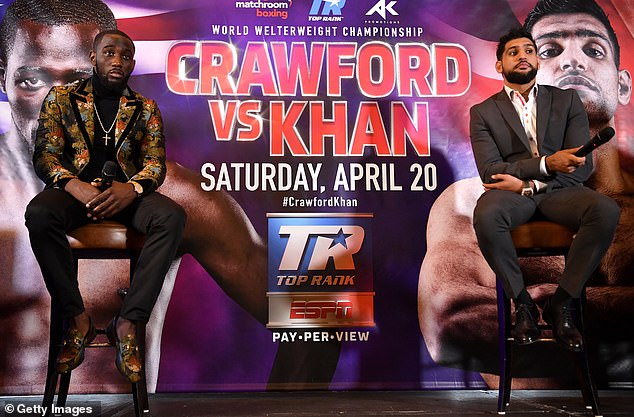 Amir Khan (right) has decided to challenge the world welterweight champion Terence Crawford