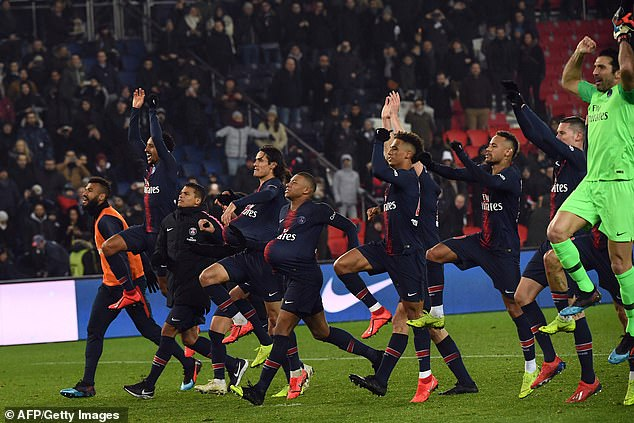 The PSG team celebrate with their fans after their biggest league win in their history