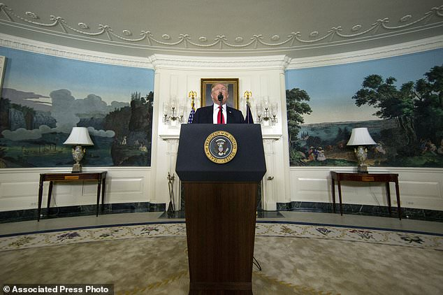President Donald Trump speaks about the partial government shutdown, immigration and border security in the Diplomatic Reception Room of the White House, in Washington, Saturday, Jan. 19, 2019. (AP Photo/Alex Brandon)