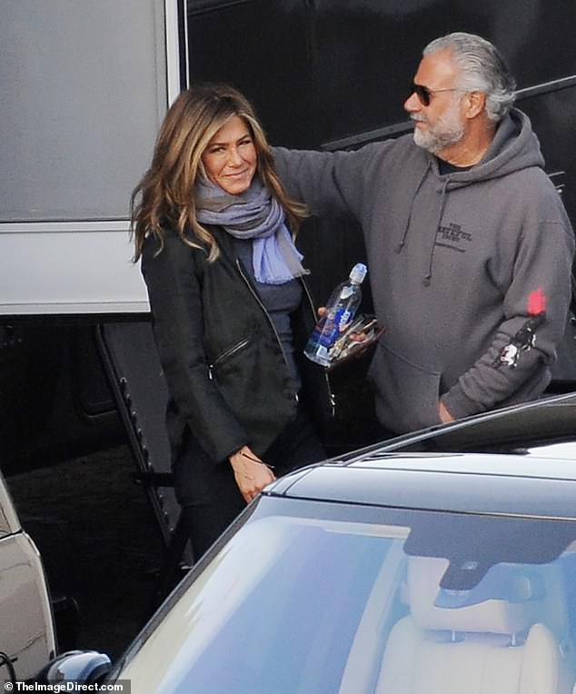 You glow, girl: Jennifer Aniston has the type of thick, long, healthy hair that everyone in American wants. And on Tuesday the actress - whose 50th birthday falls on February 11 - was showing off her mane as she was seen exiting the set of her new TV show Top Of The Morning