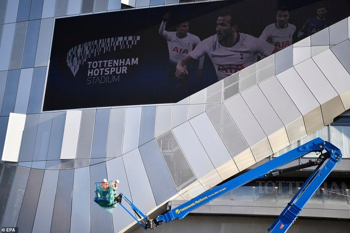 Work on the stadium facade continues as the final touches are applied to the new Tottenham home