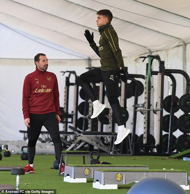 Suarez went through his paces under the observation of Arsenal fitness coach Julen Masach