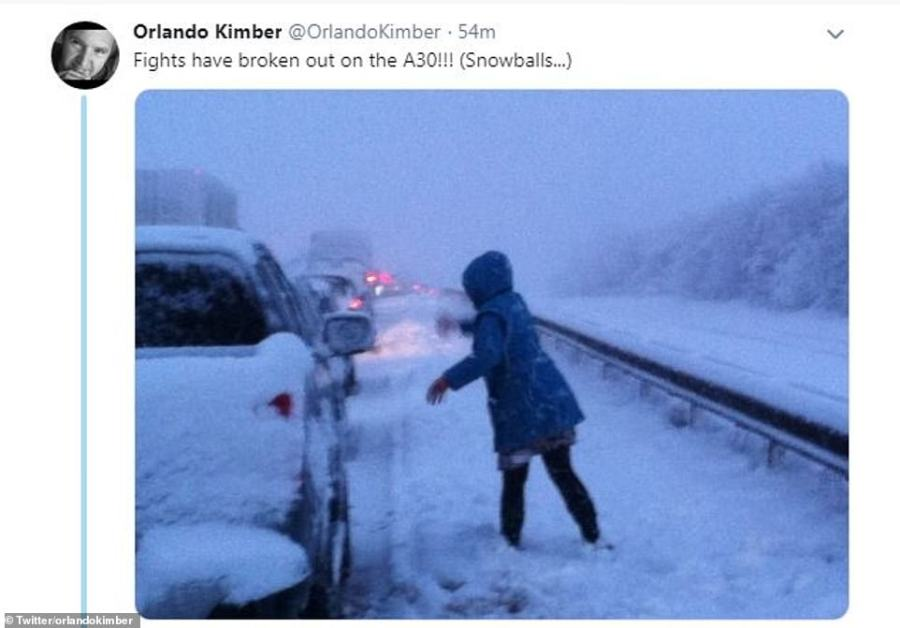 Some motorists stuck on the A30 this evening are taking advantage of the conditions to take part in a quick snowball fight