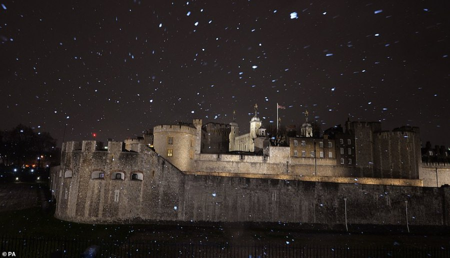 The Tower of London during a light snow shower in London this evening. The snow is expected to continue in the capital until tomorrow morning when the temperature is expected to rise
