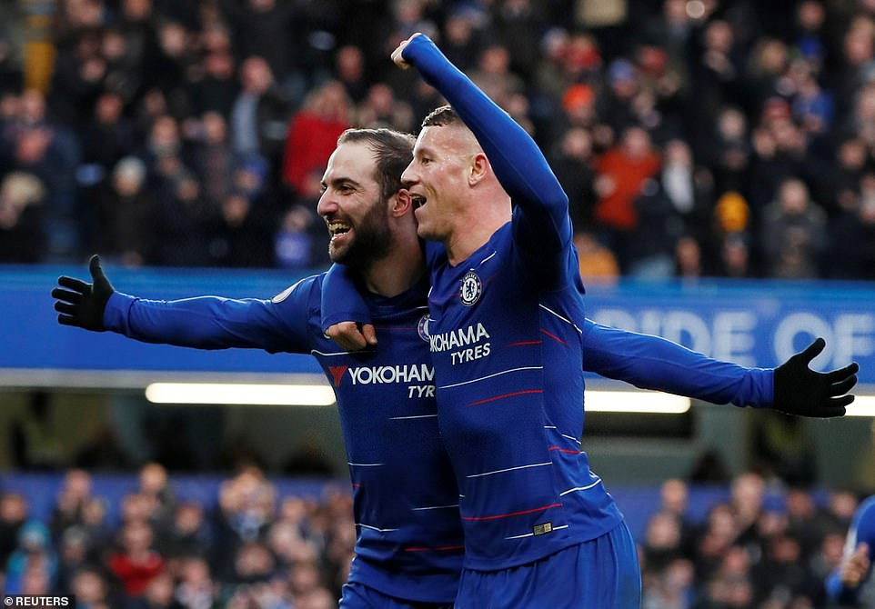 After scoring his spectacular second goal, and Chelsea's fourth,  Higuain celebrates with team-mate Ross Barkley